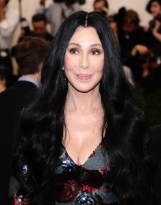 """FILE - In this May 4, 2015 file photo, Cher arrives at The Metropolitan Museum of Art's Costume Institute benefit gala celebrating """"China: Through the Looking Glass"""" in New York. From drought-shaming to eco-boasting, willing or not, celebrities play a role in raising awareness about the debilitating drought in Calif. Cher, a Malibu resident, has let her grass go brown and has talked about the water shortage on Twitter. (Photo by Charles Sykes/Invision/AP, File)"""